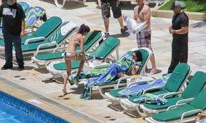 th 800487942 Celebutopia netSelenaGomez19 122 197lo Selena Gomez gets a Brazilian tan while at a pool at her hotel in Rio 2 4 12 x36