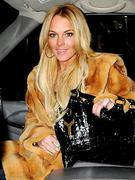 female celebrities wearing fur clothing